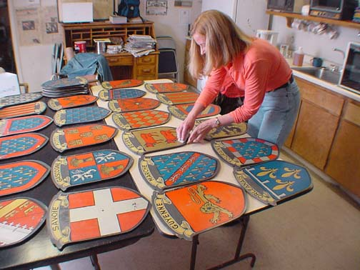 Curator of History Jane O'Cain cleaning the decorative shields prior to them